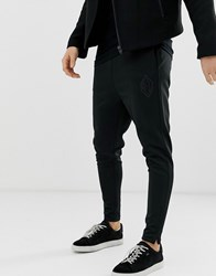 Religion Tapered Fit Joggers In Black With Zip Hem