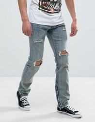 Reason Jeans In Light Wash With Distressing Blue