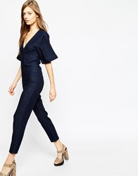 Asos Denim Straight Leg Jumpsuit With V Neck And Wide Sleeve In Indigo