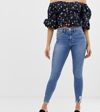 River Island Molly Skinny Jeans With Raw Hem In Mid Wash Blue