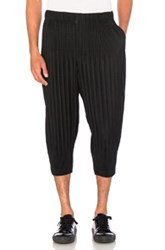 Homme Plisse Issey Miyake Pleated Cropped Trousers In Black