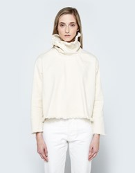 Ashley Rowe Fitted Turtleneck In Cream
