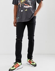 Cheap Monday Tight Skinny Jeans In Black With Knee Rips