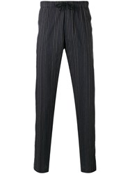 Dries Van Noten Striped Tapered Trousers Blue