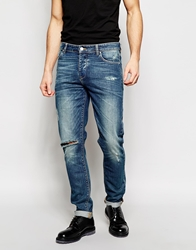 Asos Skinny Jeans In Mid Wash With Rips Blue