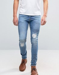 Asos Super Skinny Embroidered Jeans With Rips In Mid Wash Mid Blue