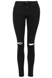 Topshop Moto Washed Black Ripped Leigh Jeans