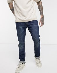 Bellfield Tappered Leg Jeans In Washed Indigo Blue