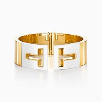Tiffany And Co. T Cutout Hinged Cuff In 18K Gold With White Ceramic Small. No Gemstone