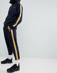 Mennace Skinny Jogger In Navy With Gold Side Stripe