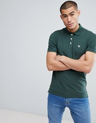 f9301c678 Abercrombie And Fitch Stretch Pique Slim Fit Polo Icon Moose Logo In Green  Deep Forest