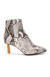 Vetements Python Embossed Ankle Boots In Animal Print Gray Animal Print Gray