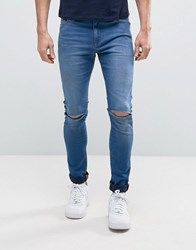 Asos Super Spray On Jeans With Knee Rips In Mid Blue Mid Blue