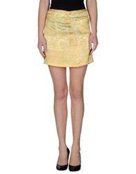 Beayukmui Mini Skirts Yellow