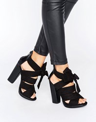 Little Mistress Black Crossover Strap Peep Toe Heel With Oversized Bow. Black