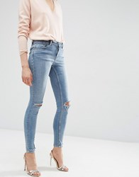 Asos Lisbon Mid Rise Skinny Jeans In Shelby Light Stonewash With Shredded Knees And Chewed Hems Mid Wash Blue