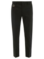 Dolce And Gabbana Crown Embellished Wool Blend Crepe Trousers Black