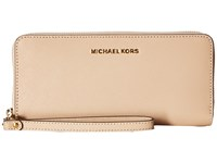 Michael Michael Kors Jet Set Travel Travel Continental Oyster Clutch Handbags Beige