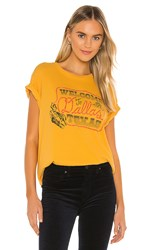 Daydreamer Welcome To Dallas Tour Tee In Mustard. Marigold