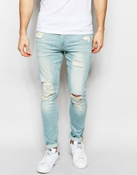 Asos Super Skinny Jeans With Extreme Rips In Bleach Blue Bleachblue
