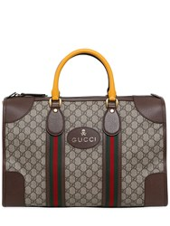 Gucci Gg Supreme And Leather Small Duffle Bag