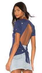 Chaser Cropped Open Tie Back Tee In Blue. Star Print