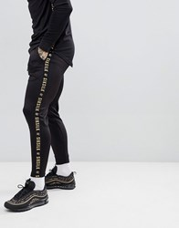 Sik Silk Siksilk Cropped Jogger In Black With Gold Side Stripe