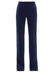 Alexander Mcqueen Longline Flared Virgin Wool Twill Trousers Navy