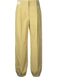 Christophe Lemaire Flared Trousers Women Cotton 40 Yellow Orange