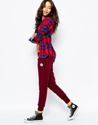 Converse Cuffed Skinny Sweat Pants With Tie Front And Small Logo Tracksuit Red