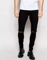 Asos Spray On Jeans With Knee Rip In Black