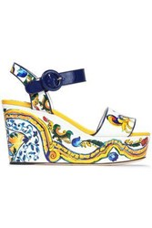 Dolce And Gabbana Printed Patent Leather Wedge Sandals Yellow