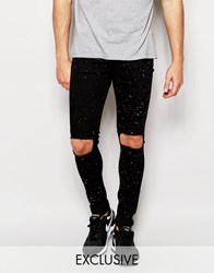 Reclaimed Vintage Super Skinny Jeans With Knee Rips And Paint Splatter Black