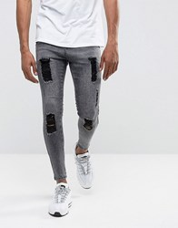 Illusive London Super Skinny Jeans In Acid Wash Black With Distressing Black