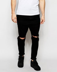 Asos Drop Crotch Jeans In Black With Knee Rips