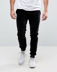 Asos Super Skinny Joggers In Velour Black