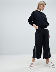 Native Youth Wide Leg Trouser With Contrast Flared Panel Black Olive