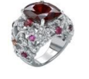 Garrard An 18Ct White Gold Bombe Cocktail Ring From The Tudor Rose Collection Set With A Central Cushion Red Spinel Surrounded By Round White Diamonds Rubies Red Spinels And Garnets.