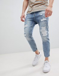 Stradivarius Carrot Fit Jeans With Zips And Abrasion In Light Blue Light Wash