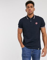 Pretty Green Live Forever Badge Logo Polo Shirt In Navy