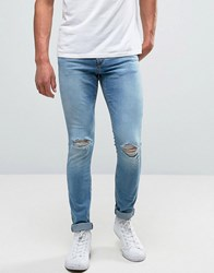 Pull And Bear Pullandbear Super Skinny Jeans With Knee Rips In Mid Wash Blue