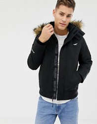 c7b3051183a49 Hollister All Weather Borg Lined Hooded Bomber Faux Fur Trim In Black Black  Brown