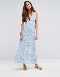 Goldie Riveria Ditsy Printed Maxi Dress With Low Neckline And Cross Straps At The Back Multi