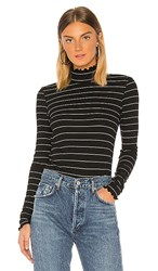 Paige Cadence Turtleneck In Black Metallic Silver. Black And Silver