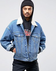 Asos Oversized Denim Jacket In Mid Blue Wash With Borg Collar Mid Wash