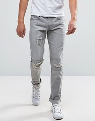 Bellfield Slim Jeans With Rip And Repair Detailing Washed Denim Blue