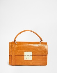Glamorous Croc Clutch With Top Handle And Lock Detail Tan