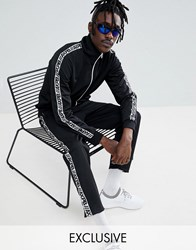 Pull And Bear Pullandbear Exclusive Tracksuit Bottoms In Black With Logo Side Stripe