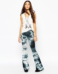 Lira Bell Bottom Flare Trousers With All Over Tye Dye Print Black