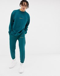 Mennace Joggers In Green With Script Logo